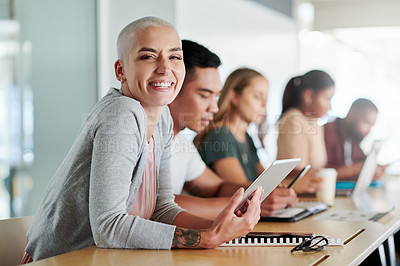 Buy stock photo Cropped portrait of an attractive young businesswoman sitting in the boardroom with her colleagues during a seminar