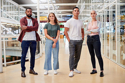 Buy stock photo Full length portrait of a group of young businesspeople standing in the corridor of their creative office
