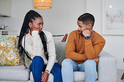 Buy stock photo Shot of a young couple looking upset with each other  at home