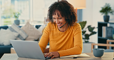 Buy stock photo Shot of a young woman using a laptop and headset at home