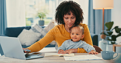 Buy stock photo Shot of a young woman using a laptop while caring for her adorable baby girl at home