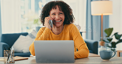 Buy stock photo Shot of a young woman using a laptop and smartphone while working from home