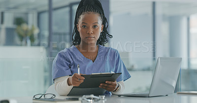 Buy stock photo Shot of a female nurse filling in a patients chart
