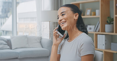 Buy stock photo Shot of a young woman using a phone at home