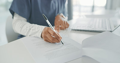 Buy stock photo Shot of a female doctor writing reports in her office
