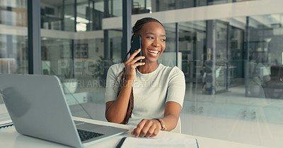 Buy stock photo Shot of a young woman talking on her cellphone in a modern office