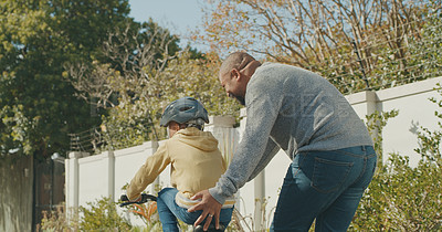 Buy stock photo Shot of a man taking his grandson for a bike ride outside
