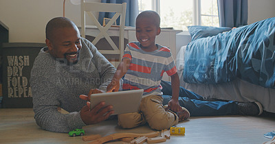 Buy stock photo Shot of a mature man and his grandson playing inside at home