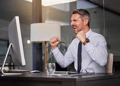 Buy stock photo Shot of a businessman looking cheerful while sitting at his desk