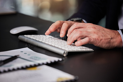 Buy stock photo Cropped shot of an unrecognisable businessman typing on his keyboard