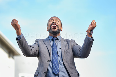 Buy stock photo Shot of a businessman looking cheerful while out in the city