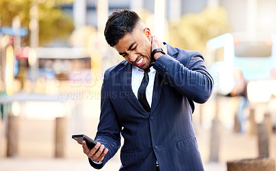 Buy stock photo Shot of a young businessman massaging his neck in pain
