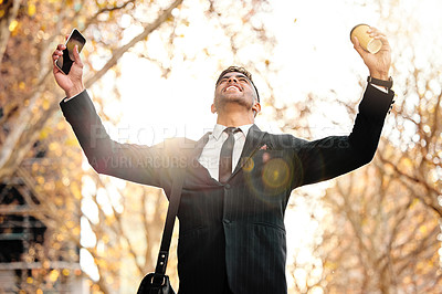 Buy stock photo Shot of a young businessman cheering in excitement