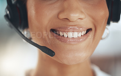 Buy stock photo Cropped shot of an unrecognizable call centre agent sitting alone in her office