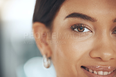 Buy stock photo Cropped shot of a young woman alone in her office