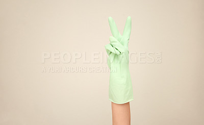 Buy stock photo Shot of an unrecognizable person showing a peace sign against a white background