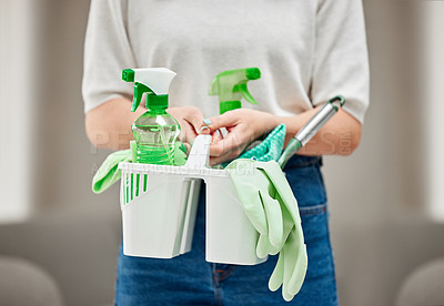 Buy stock photo Shot of an unrecognizable person holding cleaning supplies at home