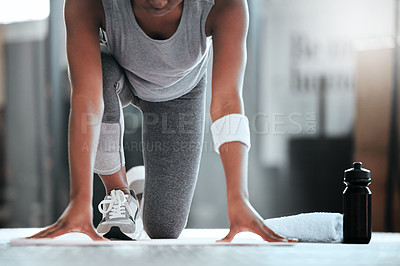 Buy stock photo Cropped shot of an unrecognizable woman getting into position for pushups at the gym