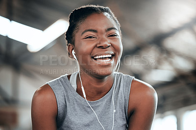 Buy stock photo Portrait of a happy woman using earphones at the gym