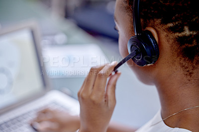 Buy stock photo Shot of an unrecognizable woman using a headset in a modern office
