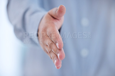 Buy stock photo Cropped shot of an unrecognizable businessman standing alone in the office and extending his hand for a handshake