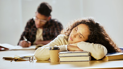 Buy stock photo Cropped shot of an attractive young female college student sleeping on her textbooks in class