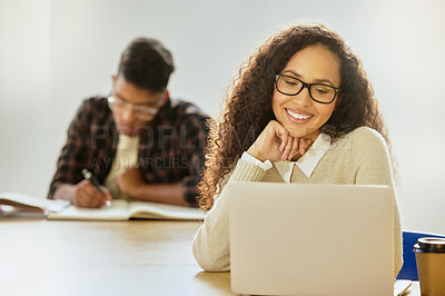 Buy stock photo Cropped shot of an attractive young female college student working on her laptop while sitting in class
