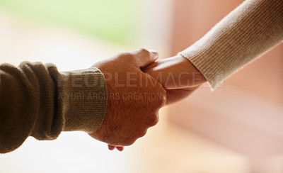 Buy stock photo Shot of an unrecognisable couple holding hands