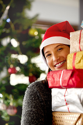 Buy stock photo Shot of a young woman carrying a stack on gifts at home