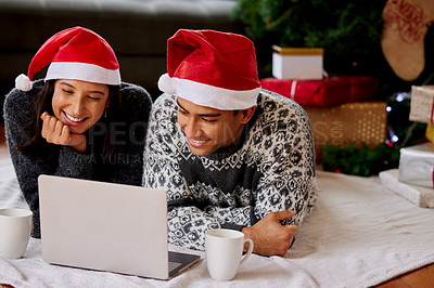 Buy stock photo Shot of a couple watching movies on a laptop at home