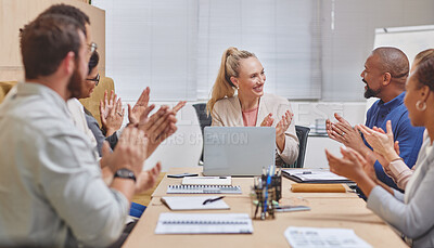 Buy stock photo Cropped shot of a group of corporate businesspeople applauding during a meeting in the boardroom