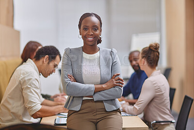Buy stock photo Cropped portrait of an attractive young businesswoman standing with her arms folded in the boardroom with her colleagues in the background