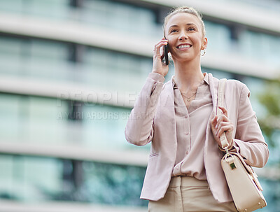 Buy stock photo Cropped shot of an attractive young businesswoman making a phonecall while out in the city