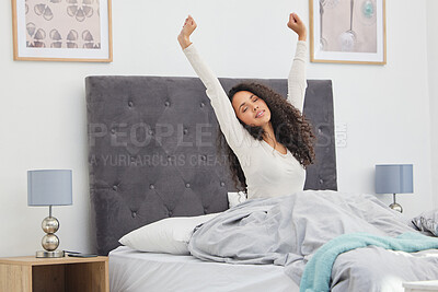Buy stock photo Shot of a young female waking up in bed at home