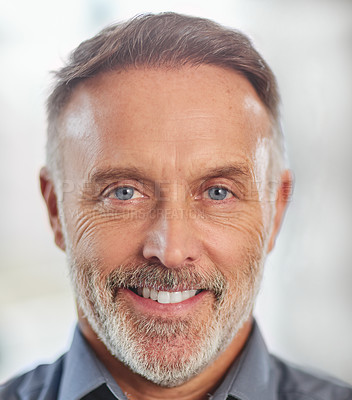 Buy stock photo Closeup portrait of a mature man smiling for the camera in a modern office