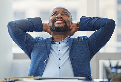Buy stock photo Shot of a handsome mature businessman sitting alone in his office with his hands behind his head in relief