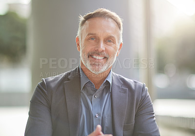 Buy stock photo Shot of a businessman sitting at his favourite coffee shop in the morning