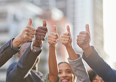Buy stock photo Shot of a group of businesspeople giving the thumbs up