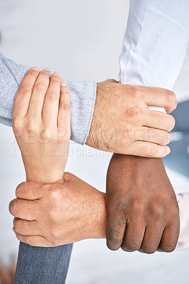 Buy stock photo Shot of a group of businesspeople holding on to each other's wrists