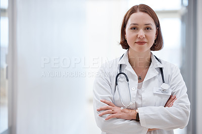 Buy stock photo Shot of a beautiful young doctor in the hospital
