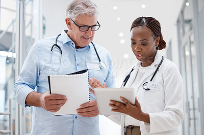 Buy stock photo Shot of two doctors discussing a patients results