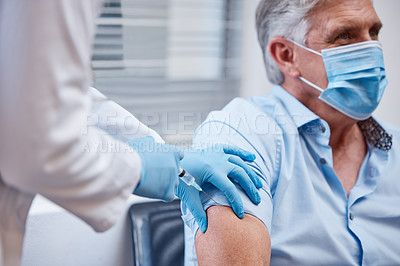 Buy stock photo Shot of a patient receiving a covid vaccination