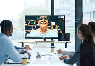 Buy stock photo Shot of a group of businesspeople having a video call with a colleague in an office
