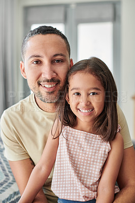 Buy stock photo Shot of a young father and daughter spending time together at home