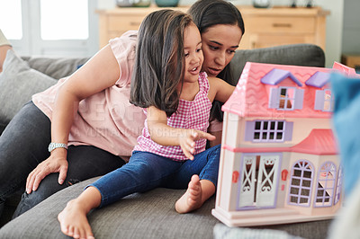 Buy stock photo Shot of a young mother and daughter playing at home