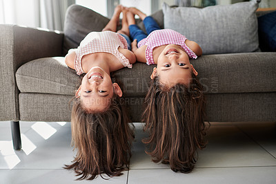 Buy stock photo Shot of two little girls sitting on the couch at home