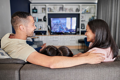 Buy stock photo Shot of a young family watching tv at home