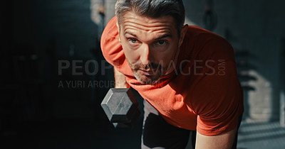 Buy stock photo Shot of a handsome mature man using dumbbells during his workout in the gym