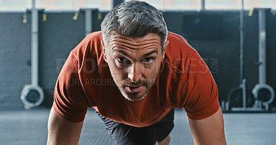 Buy stock photo Shot of a mature man doing mountain climbers during his workout