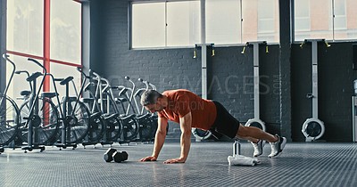 Buy stock photo Shot of a mature man doing pushups in a gym